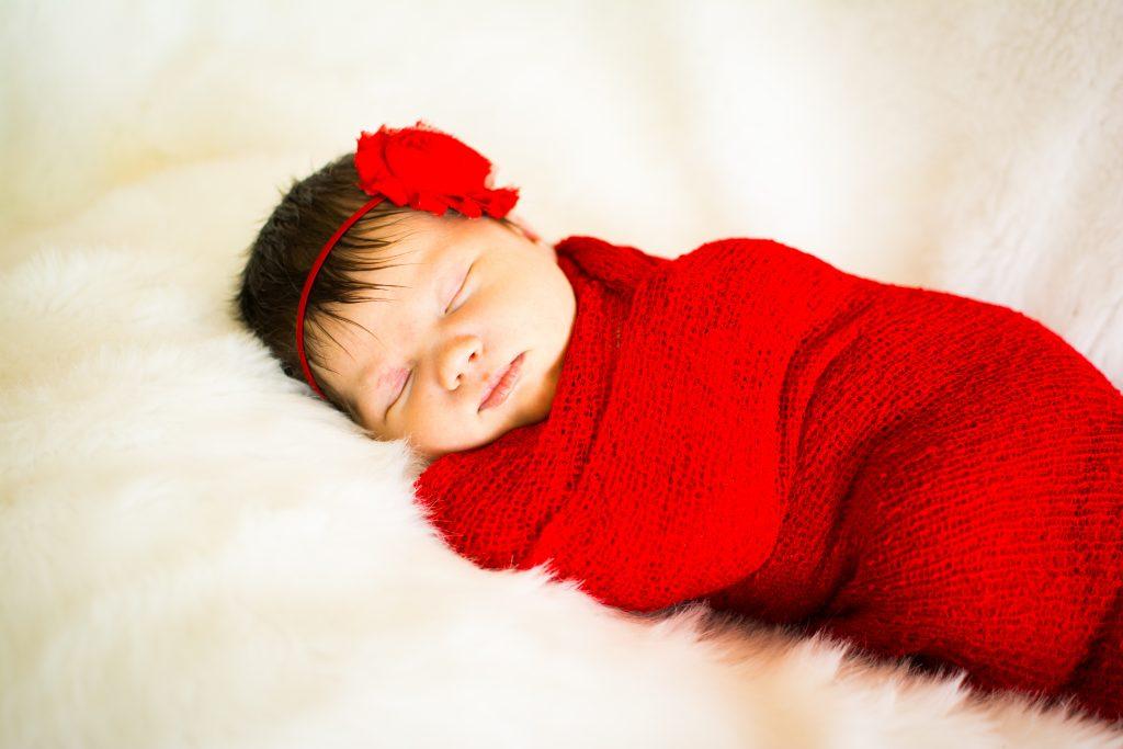 Newborn photo shoot. Newborn and family photo shoot. Baby girl newborn photo shoot. Red swaddle newborn photos