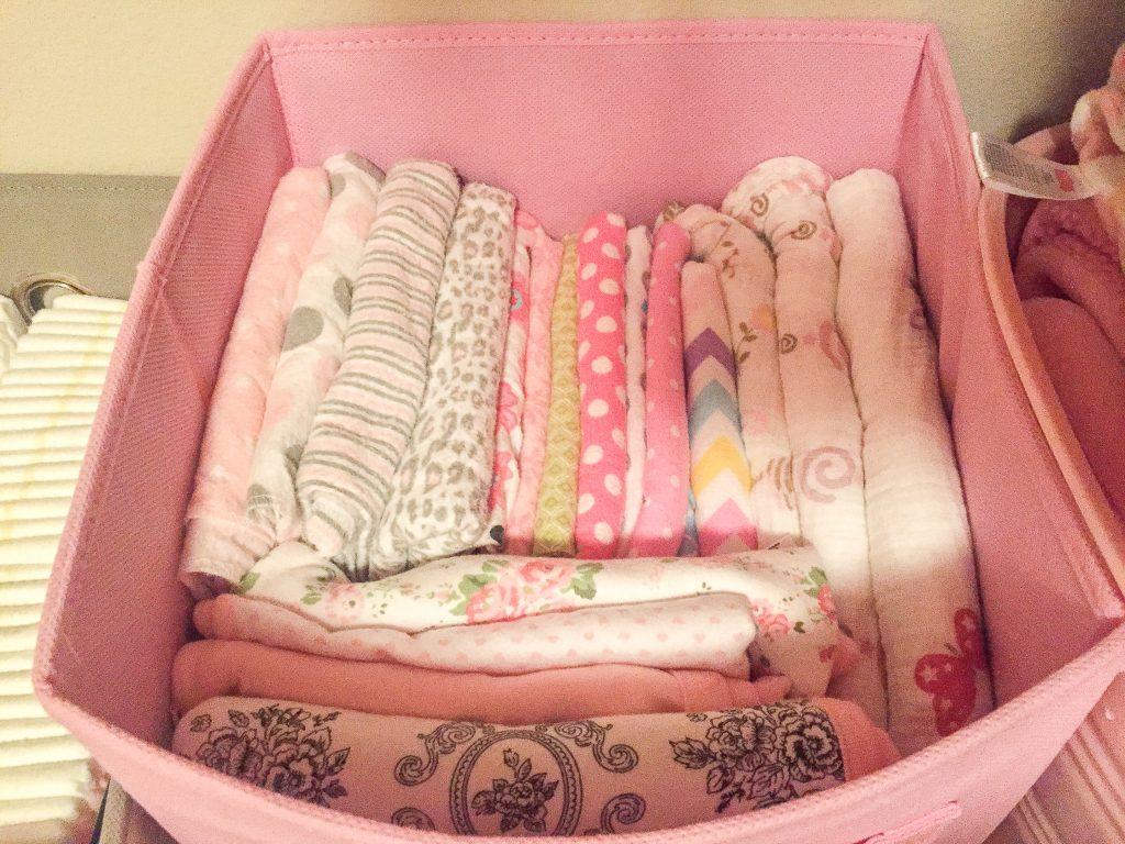 Aqua and pink nursery. Aqua and pink nursery with bird accents. Nursery storage solutions.