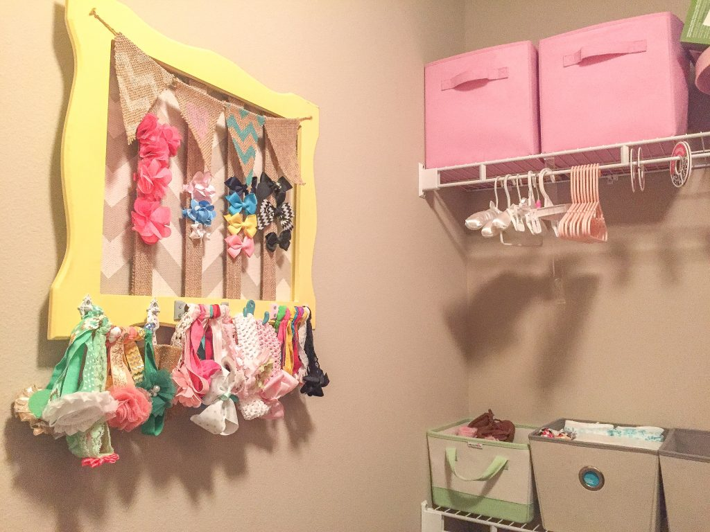 Aqua and pink nursery. Aqua and pink nursery decor with bird accents. Nursery storage solutions.