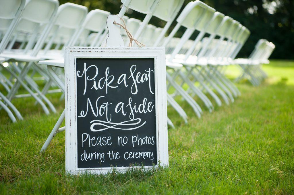 Handlettered chalkboard signs. Wedding chalkboard signs. Pick a seat, not a side wedding chalkboard sign. Wedding reception chalkboard sign. Wedding ceremony chalkboard sign.