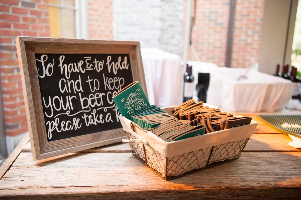 """Handlettered chalkboard signs. Wedding chalkboard signs. """"To have and to hold and to keep your beer cold"""" chalkboard sign for wedding favors. Wedding reception chalkboard sign. Wedding ceremony chalkboard sign."""