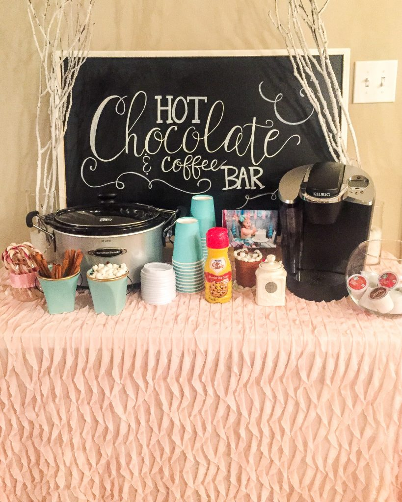 Winter ONEderland 1st birthday party decoration ideas. Food table backdrop and decorations. Hot chocolate and coffee bar chalkboard sign. Winter ONEderland hot chocolate party favors. First birthday outfit