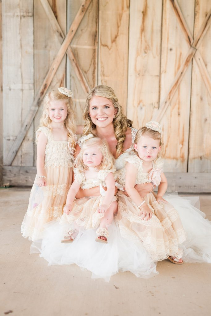 Rustic barn wedding meets vintage fairy tale. Meadow Creek Farm North Alabama wedding venue. Vintage Beauty and the Beast inspired wedding reception decoration ideas. Lace, mermaid style wedding gown. Half up curly bridal hair with braids. Pink and white bridal bouquet. Bride and groom first look. Flower girl dresses