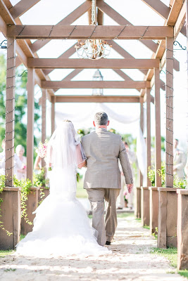 Rustic barn wedding meets vintage fairy tale. Meadow Creek Farm North Alabama Wedding Venue. Vintage Beauty and the Beast inspired wedding reception decoration ideas. Lace, mermaid style wedding dress. Wooden arbor over walkway