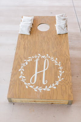 Rustic barn wedding meets vintage fairy tale. Meadow Creek Farm North Alabama Wedding Venue. Vintage Beauty and the Beast inspired wedding reception decoration ideas. Game area at wedding reception. DIY cornhole board