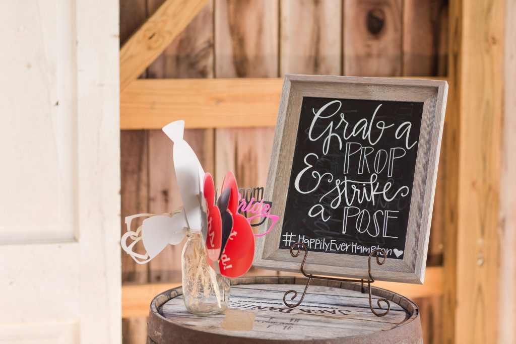 Rustic barn wedding meets vintage fairy tale. Meadow Creek Farm North Alabama wedding venue. Vintage Beauty and the Beast inspired wedding reception decoration ideas. Lace, mermaid style wedding gown. Half up curly bridal hair with braids. Wedding reception games. Wedding reception photo booth