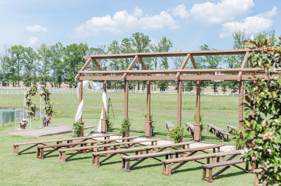 Rustic barn wedding meets vintage fairy tale. Meadow Creek Farm North Alabama wedding venue. Vintage Beauty and the Beast inspired wedding reception decoration ideas. Wooden arbor over aisle. Outdoor ceremony