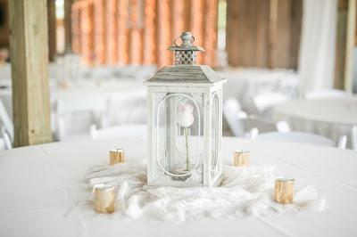 Rustic barn wedding meets vintage fairy tale. Meadow Creek Farm North Alabama Wedding Venue. Vintage Beauty and the Beast inspired wedding reception decoration ideas. Single enchanted rose centerpieces in lantern. Princess party ideas