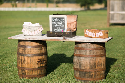 Rustic barn wedding meets vintage fairy tale. Meadow Creek Farm North Alabama Wedding Venue. Vintage Beauty and the Beast inspired wedding reception decoration ideas. Guest book sign in table. Sign a puzzle piece
