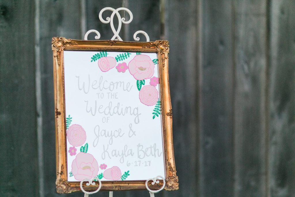 Rustic barn wedding meets vintage fairy tale. Meadow Creek Farm North Alabama wedding venue. Vintage Beauty and the Beast inspired wedding reception decoration ideas. Lace, mermaid style wedding gown. Half up curly bridal hair with braids. Handlettered wedding sign
