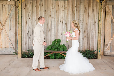 Rustic barn wedding meets vintage fairy tale. Meadow Creek Farm North Alabama Wedding Venue. Vintage Beauty and the Beast inspired wedding reception decoration ideas. Vera Wang bridesmaid dress. Lace, mermaid style wedding gown. Half up, curly wedding hair with braids. Bride and groom first look