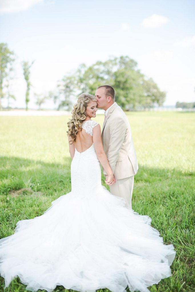 Rustic barn wedding meets vintage fairy tale. Meadow Creek Farm North Alabama wedding venue. Vintage Beauty and the Beast inspired wedding reception decoration ideas. Lace, mermaid style wedding gown. Half up curly bridal hair with braids. Pink and white bridal bouquet. Bride and groom first look.