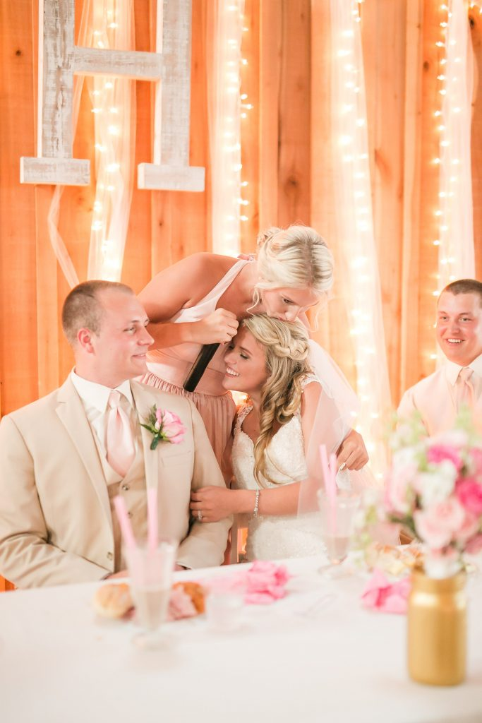 Rustic barn wedding meets vintage fairy tale. Meadow Creek Farm North Alabama wedding venue. Vintage Beauty and the Beast inspired wedding reception decoration ideas. Lace, mermaid style wedding gown. Half up curly bridal hair with braids. Pink and white bridal bouquet.