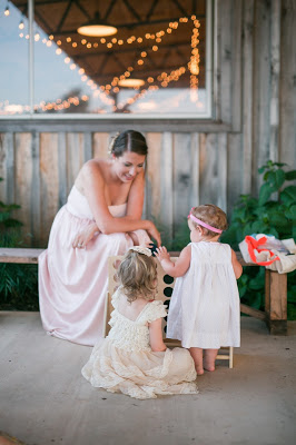 Rustic barn wedding meets vintage fairy tale. Meadow Creek Farm North Alabama Wedding Venue. Vintage Beauty and the Beast inspired wedding reception decoration ideas. Game area, DIY giant connect four