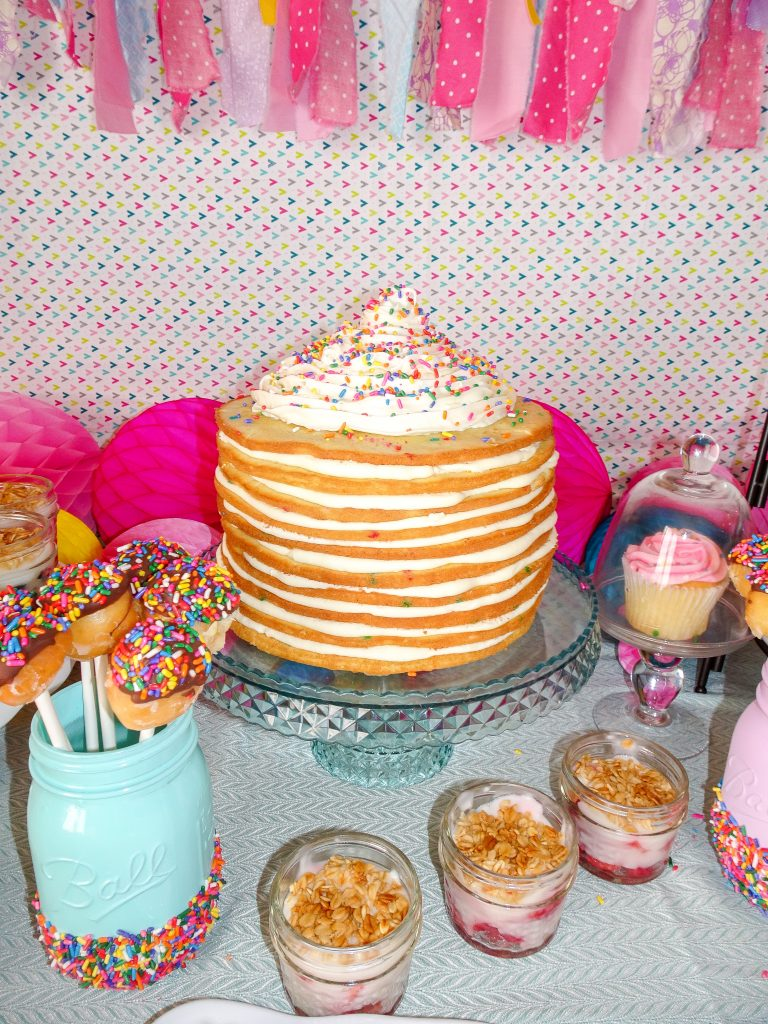 Pancakes and Pajamas birthday party decoration ideas. Pancakes and Pajamas food ideas. How to make a pancake cake. Ideas for brunch for pancakes and pajamas or donut birthday party. Sprinkles Party