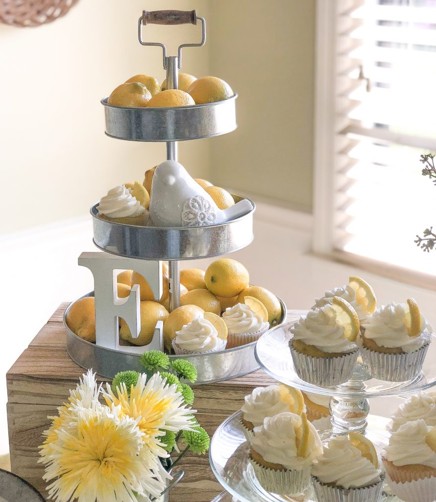 Yellow and White baby girl baby shower decoration ideas. You are my sunshine baby shower theme tips. You are my sunshine food and drinks. Lemon cupcakes. Fruit and yogurt parfait. Baby shower brunch. Gender neutral yellow and white baby shower.