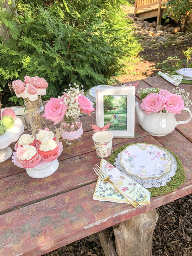 Fairy garden tea party ideas for girls. Fairy birthday party decorations. Tea party food ideas. Tinker Bell birthday party theme decoration ideas. Fairy birthday party favors. Fairy cupcakes with Tinker Bell toppers and butterfly toppers