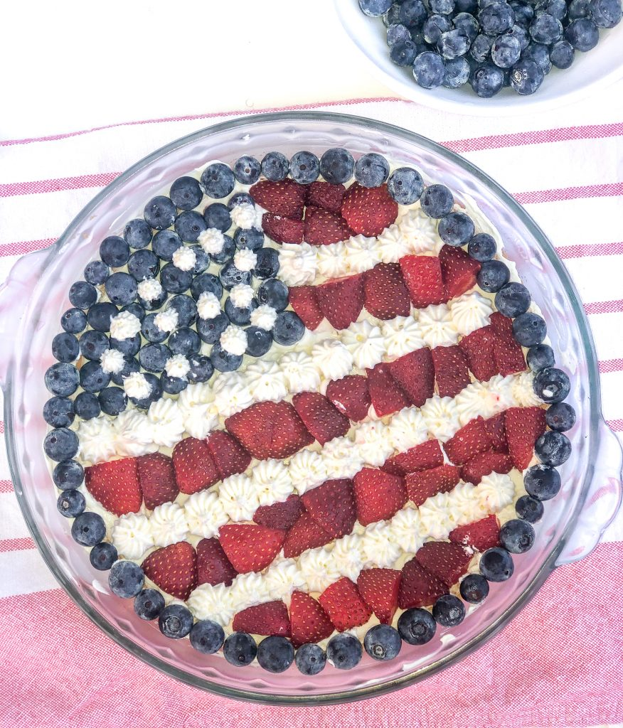 American flag fruit pizza. Patirotic fruit pizza with strawberries and blueberries. Berry pizza with sugar cookie crust. 4th of July recipes.